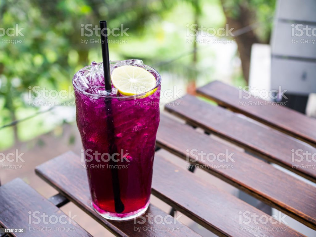 butterfly pea flower juice with sliced lemon decoration stock photo
