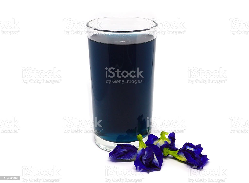 Butterfly pea flowers juice on white background stock photo