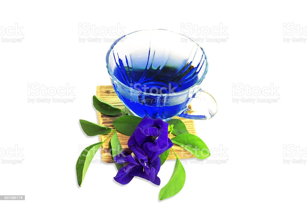 Butterfly pea juice and flowers on a white background stock photo