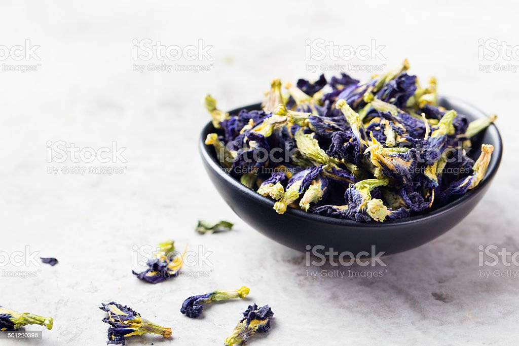 Butterfly pea tea Anchan Stone background stock photo
