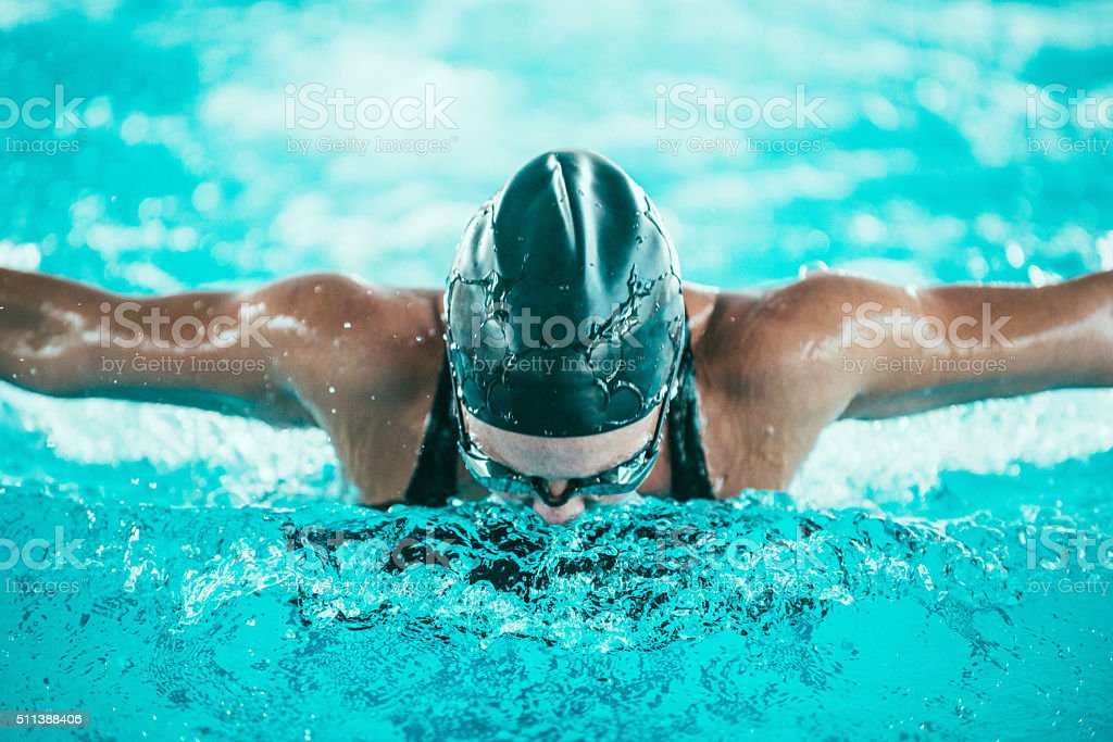Butterfly stroke swimmer, front view stock photo