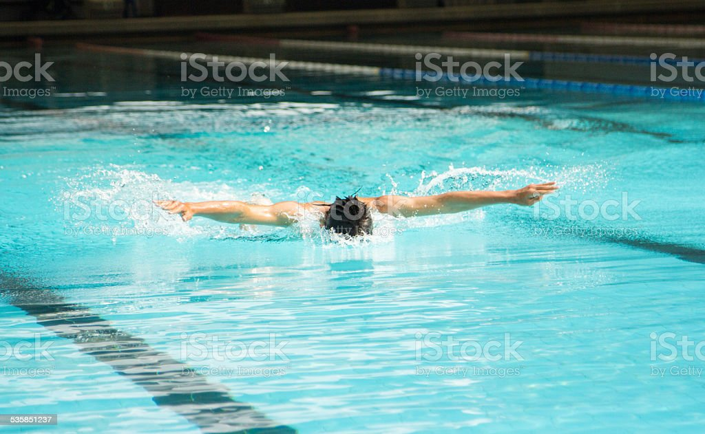 Butterfly stroke swimming stock photo