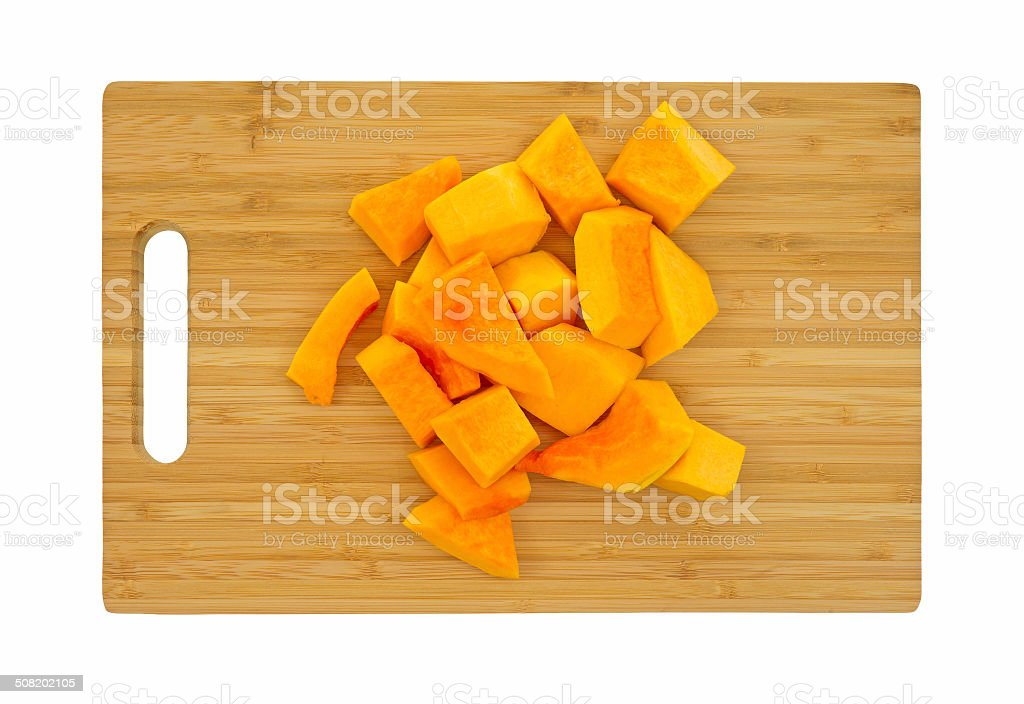 Butternut squash on cutting board stock photo