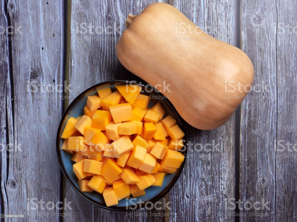Butternut squash on gray rustic background, top view stock photo