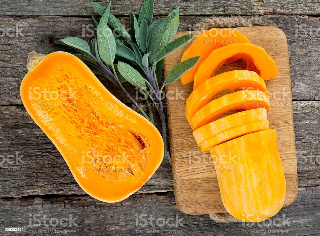 butternut squash on wooden background stock photo