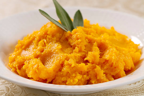 butternut squash prepared in a white bowl - gourd stock photos and pictures