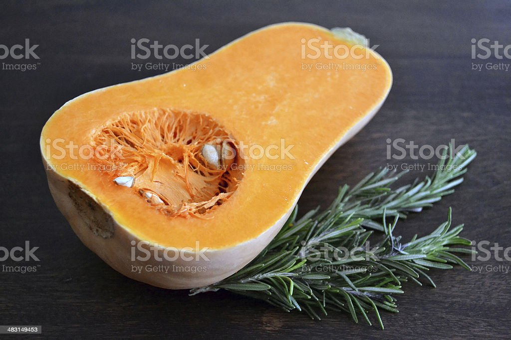 Butternut squash with rosemary stock photo