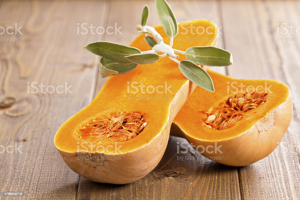 Butternut squash with sage leaves stock photo