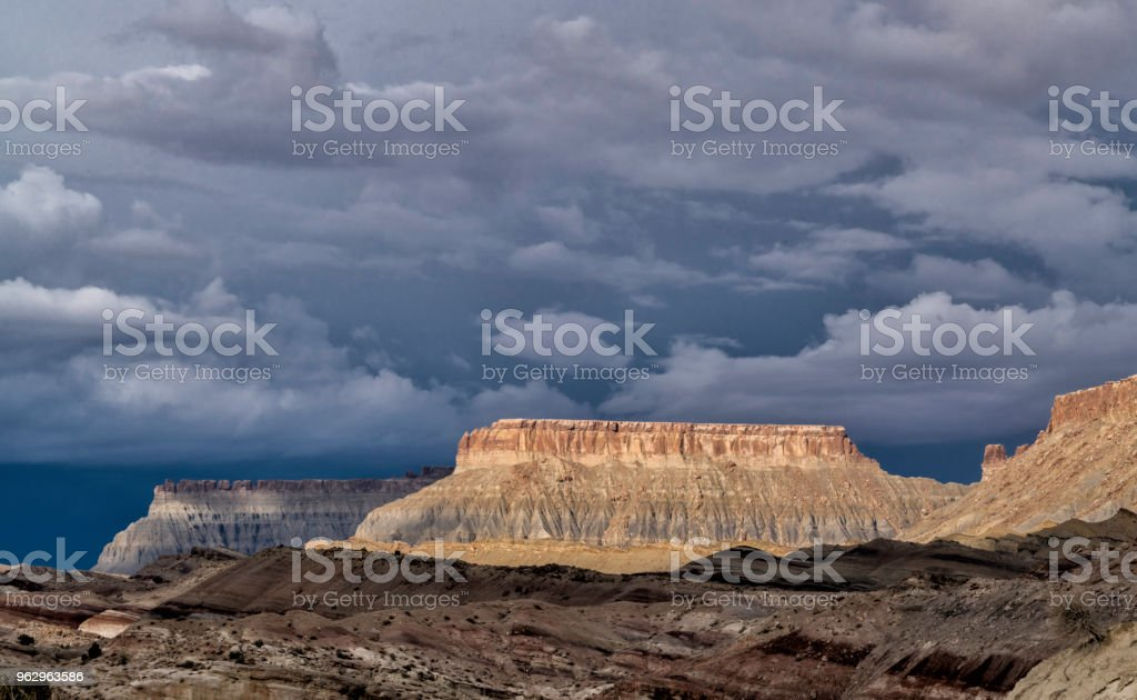 Buttes in Cainesville Badlands near Capital Reef National Park stock photo