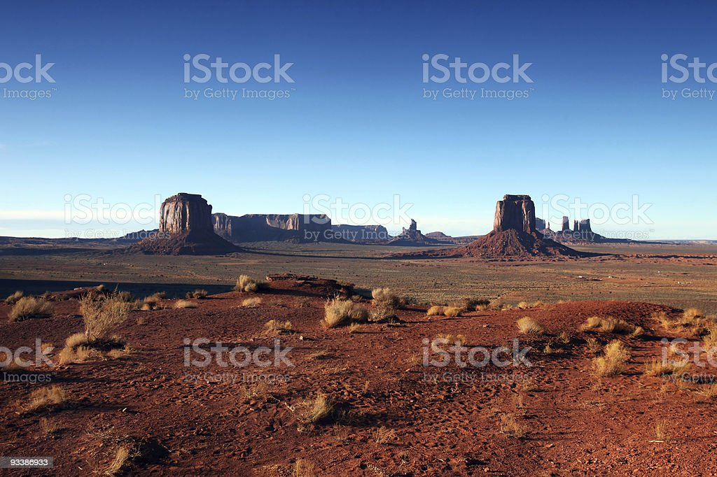 Buttes of Monumement Valley on a Clear Blue Sky Day royalty-free stock photo