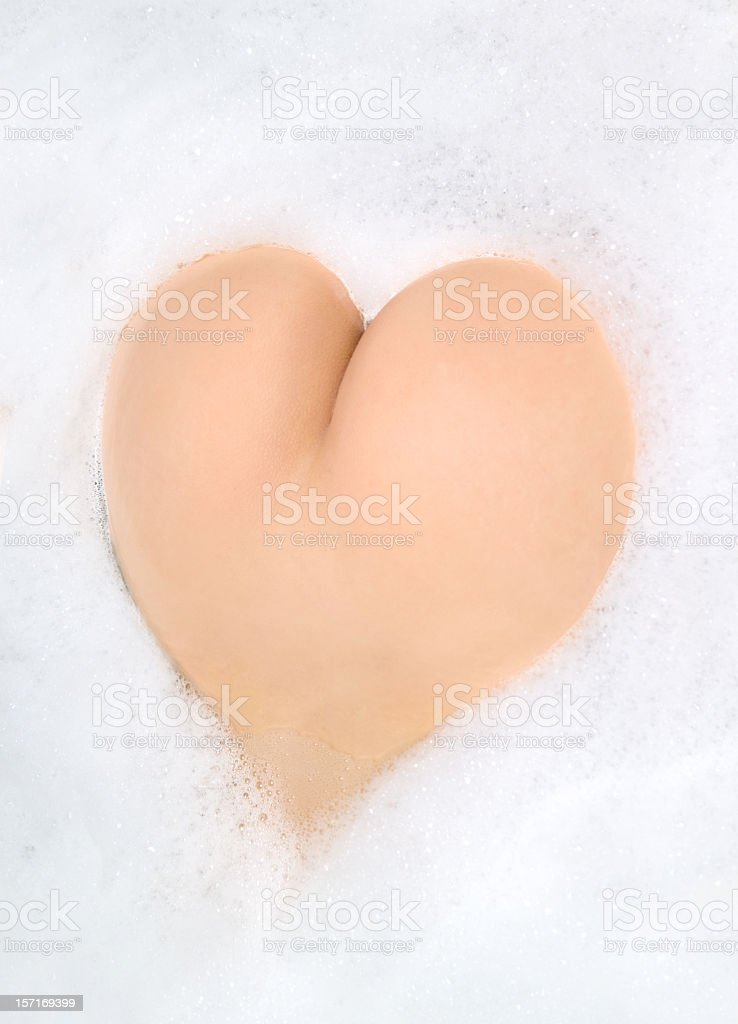 Buttocks in foam. Heart Shape royalty-free stock photo