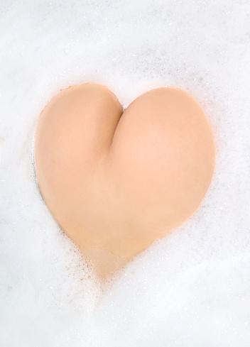 Buttocks In Foam Heart Shape Stock Photo - Download Image Now