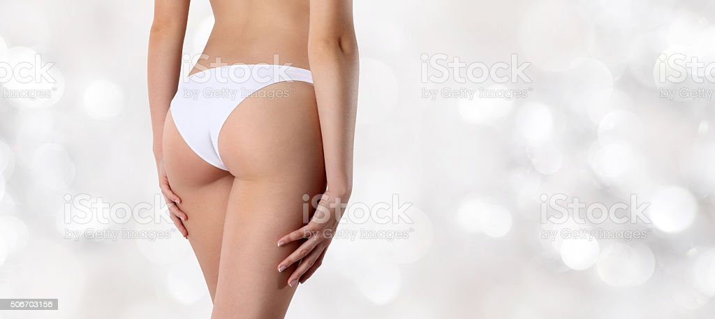 buttocks woman isolated on blurred lights background stock photo