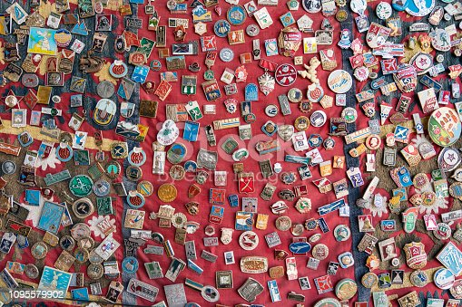 Old sport, military and other badge collection on flea market.