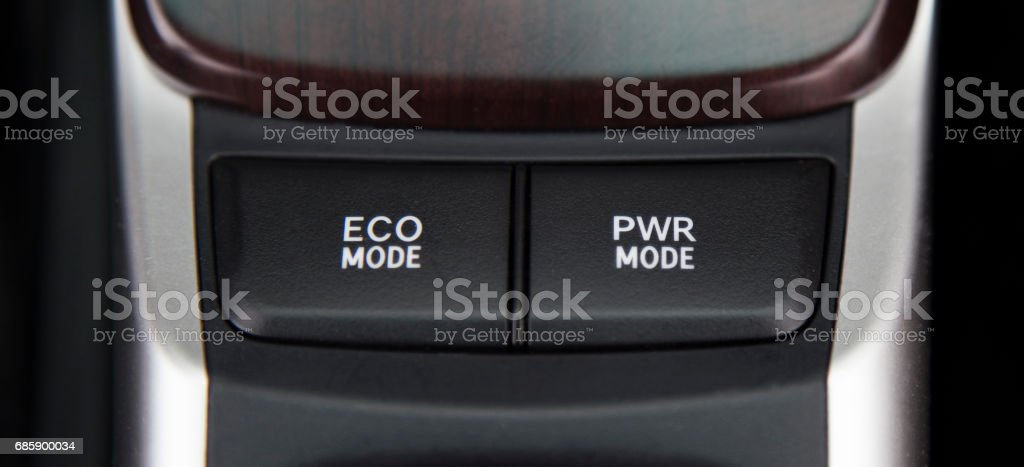 Button eco mode and power mode in car save energy stock photo