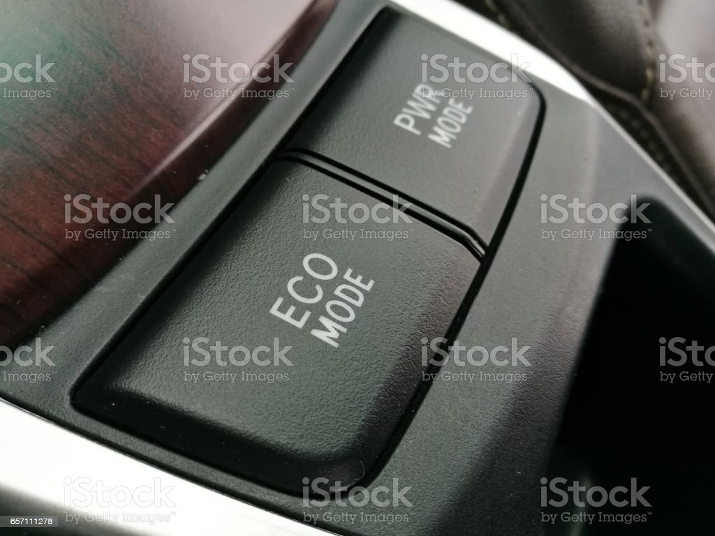 Button eco mode in car save energy stock photo