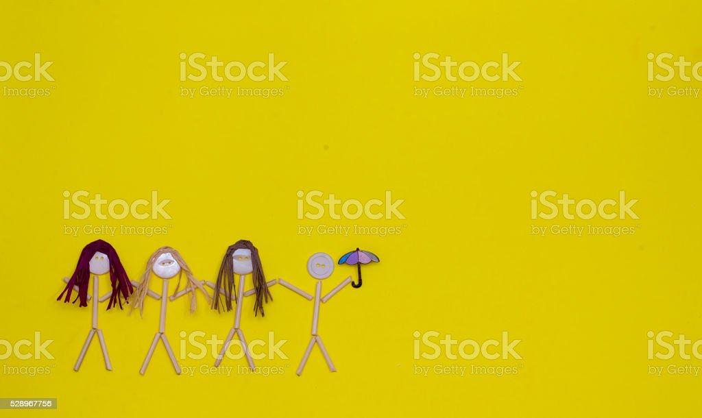 Button Head Stick Figures  Girls with Boy Holding an Umbrella stock photo