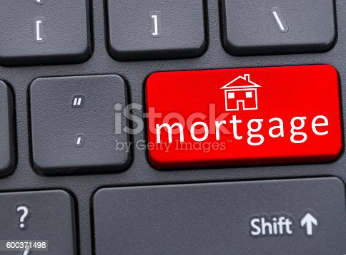 Button of mortgage text on red keyboard in closeup as financial and property concept