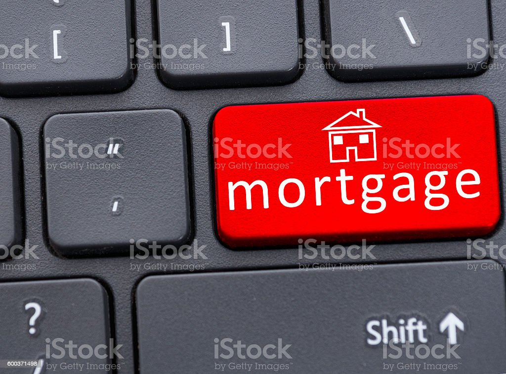 Button of mortgage text on red keyboard in closeup stock photo