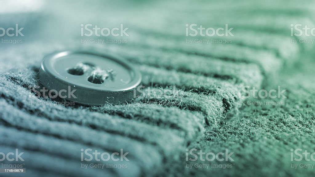 Button on a cardigan royalty-free stock photo