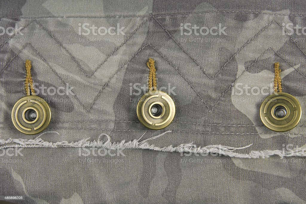 button on camouflage jacket stock photo