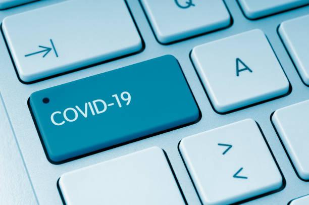 COVID-19 button stock photo