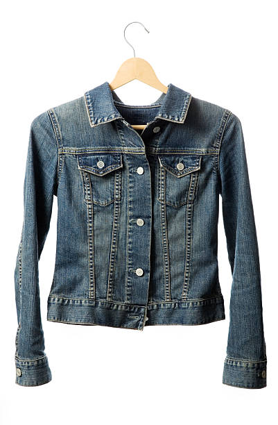 Buttoned denim jacket with hanger stock photo
