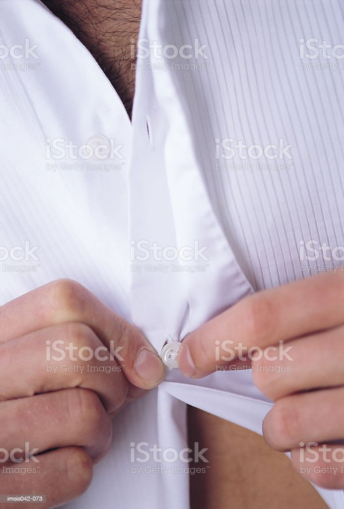 Buttoning up royalty free stockfoto