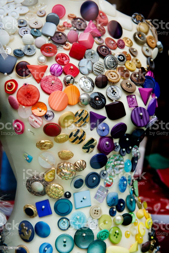 Buttons Covering a Mannequin royalty-free stock photo