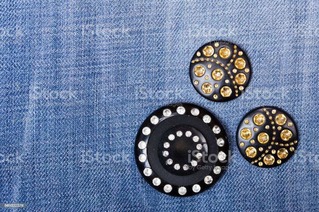 Buttons with rhinestones on denim fabric royalty-free stock photo