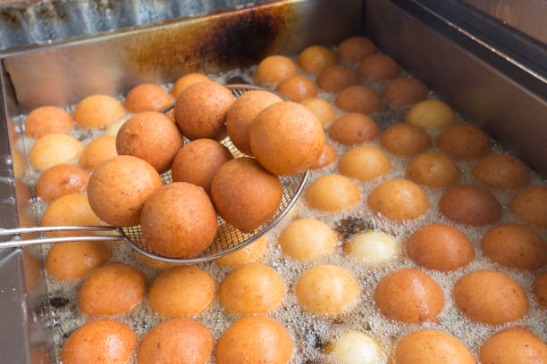 buñuelos from colombia in the process of cooking, traditional colombian food. - fritto foto e immagini stock