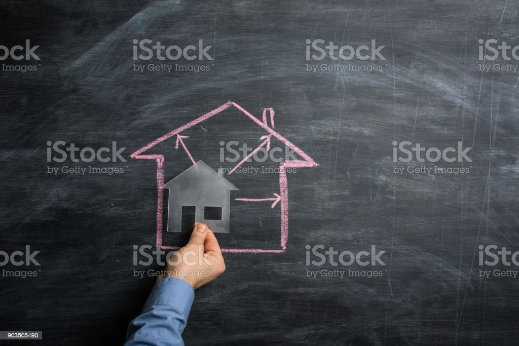 Buy a bigger house stock photo