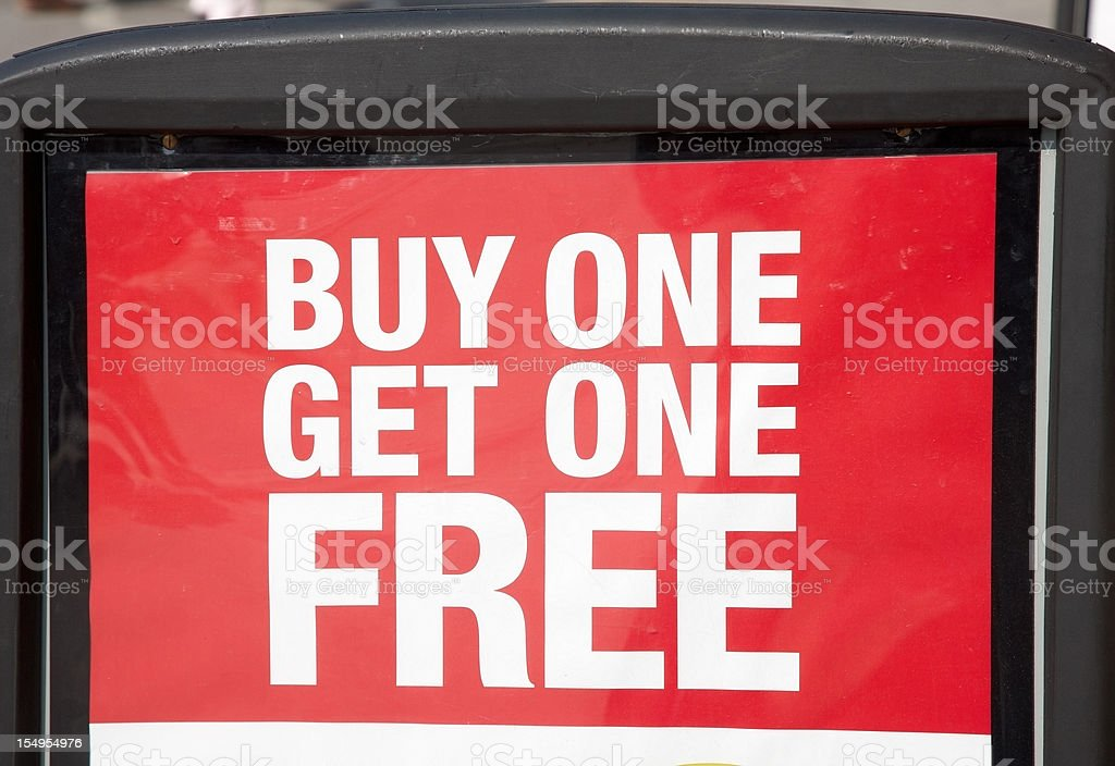 Buy and get one free advertising sign stock photo