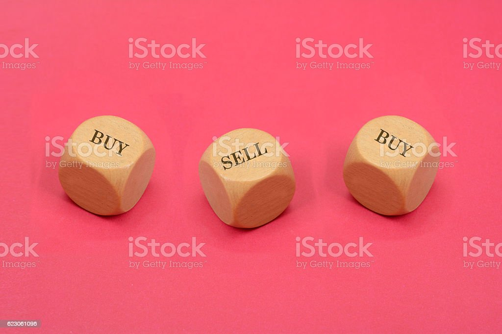 Buy and Sell Words Written on Wood Dice - Business stock photo