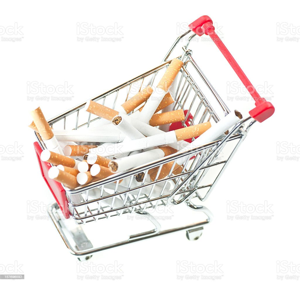 buy cigarettes in shopping cart stock photo
