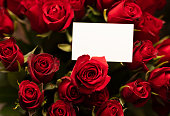 Close up of a bunch of roses with empty tag