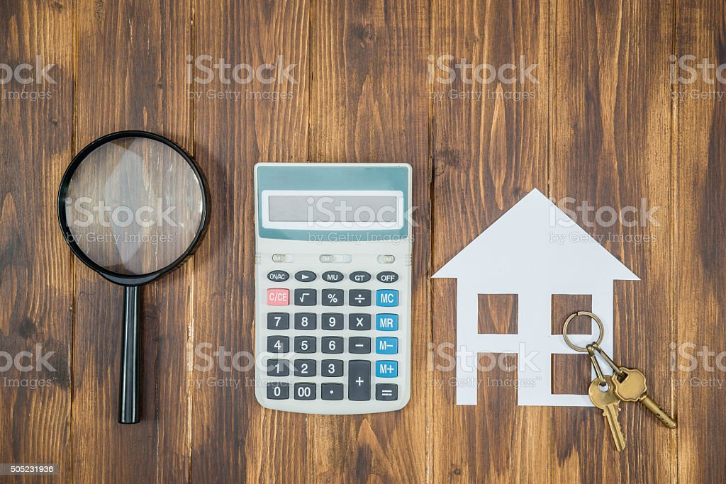 buy house Mortgage calculations,  calculator with Magnifier stock photo