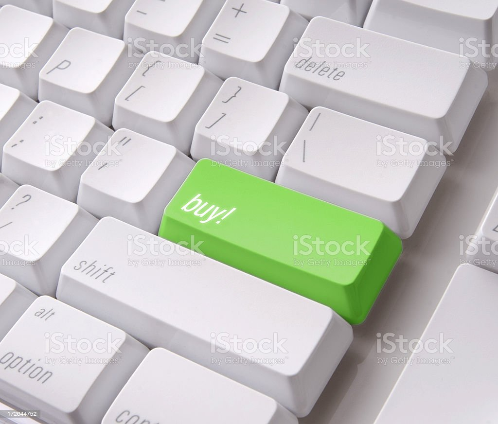 Buy key on a white computer keyboard with clipping path royalty-free stock photo