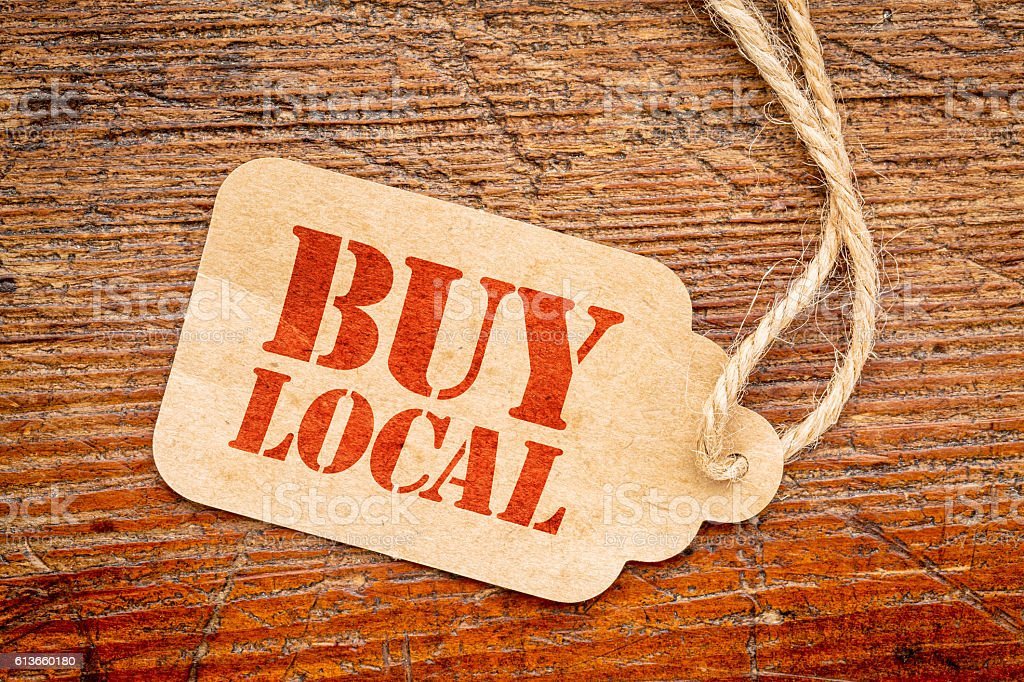 buy local sign  on a price tag stock photo