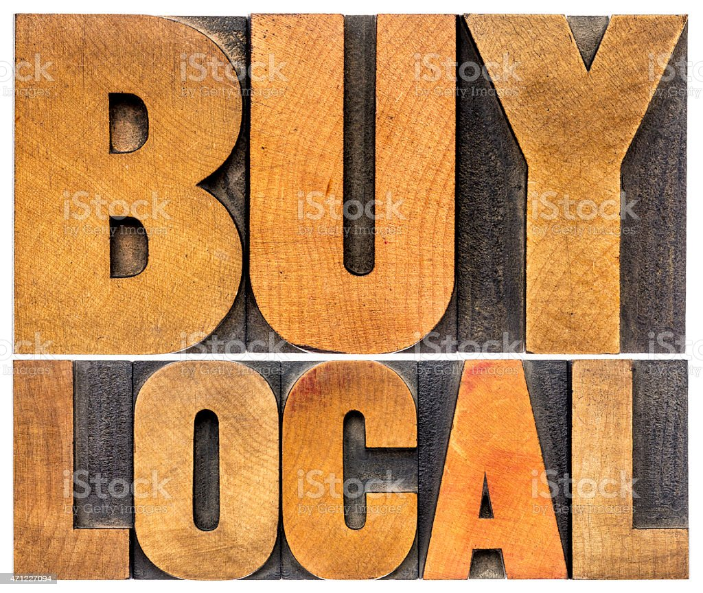 buy local words in wood type stock photo