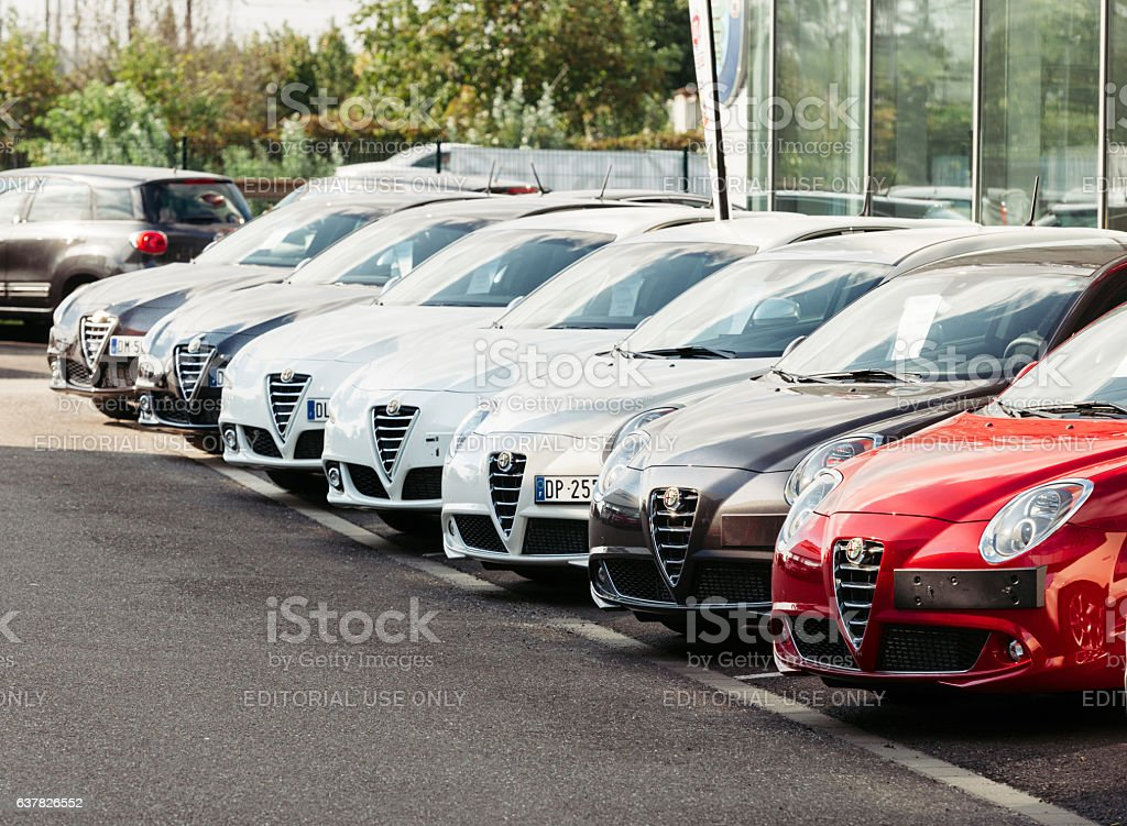 Buy new car - selecting from cars row Alfa-Romeo stock photo