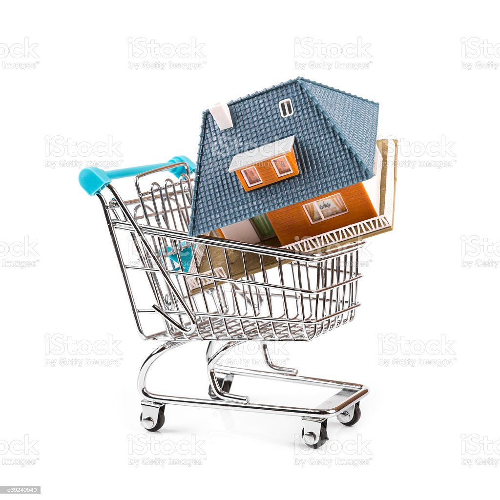 buy new real estate concept, house in a shopping cart royalty-free stock photo