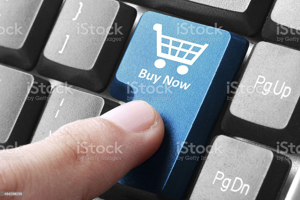Buy now button on the keyboard stock photo