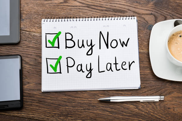 Buy Now Pay Later Concept In Notepad Buy Now Pay Later Concept In Notepad At Desk borrowing stock pictures, royalty-free photos & images