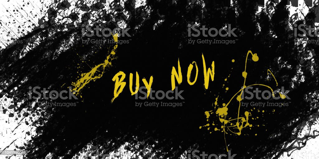buy now splatter text paint on a wall golden stock photo