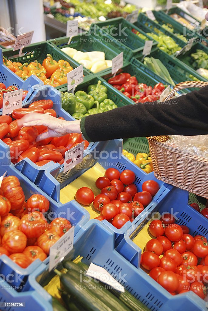 buy vegetable in market royalty-free stock photo