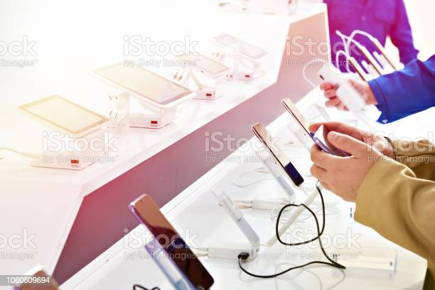 Buyer hands with mobile smartphones in electronics store picture id1060609694?b=1&k=6&m=1060609694&s=612x612&h=wj1mq mgox8dmsqoata11rm5w  f8t58uewwrkvyly0=