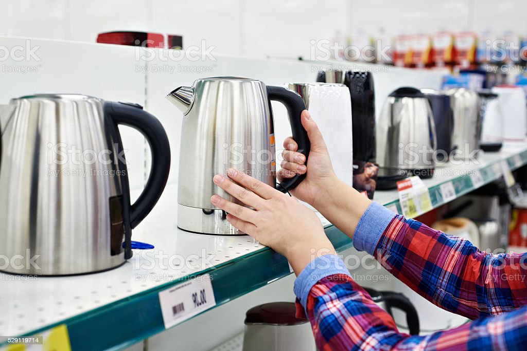 Buyer shopping for electric kettle stock photo
