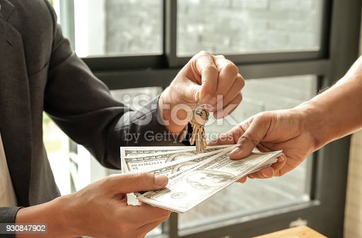 Home business concepts,Buyers and sellers give dollar money,Sellers give keys.