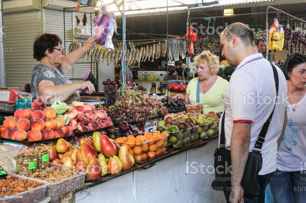 Buyers at the counter with fruit. royalty-free stock photo